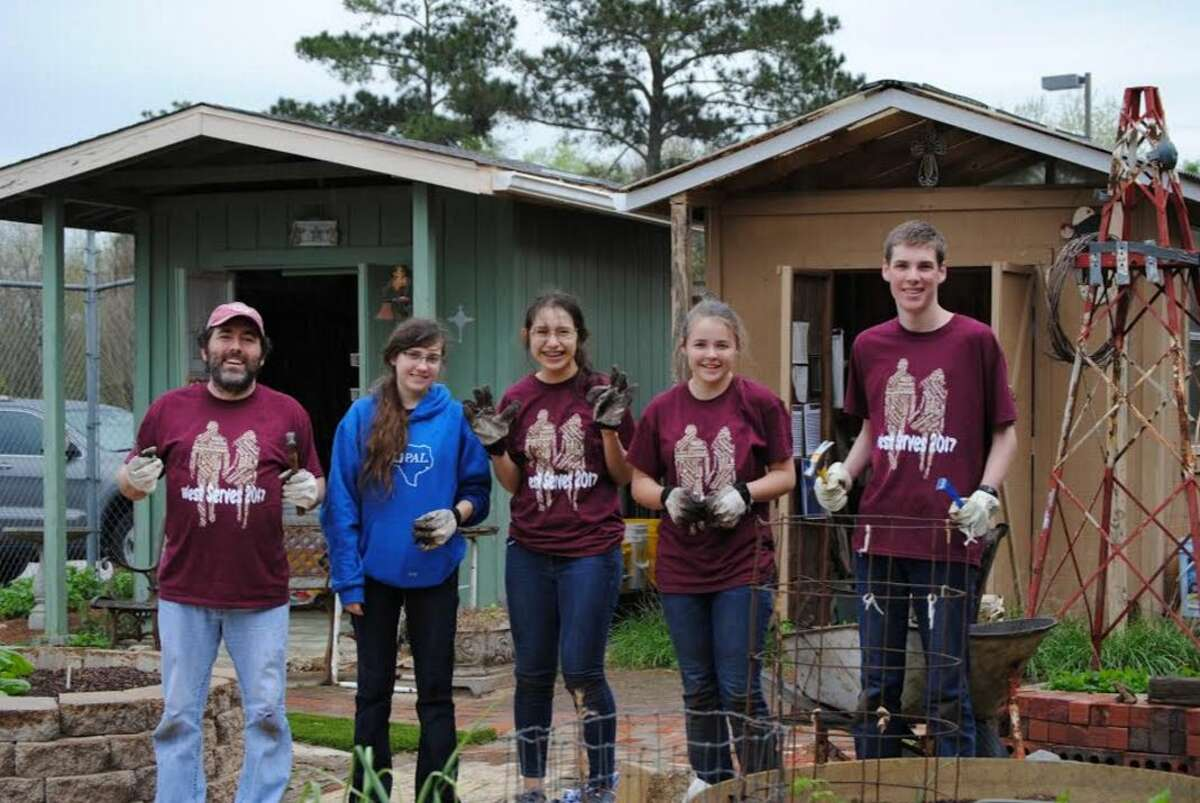 The Magnolia West STEM team working at the community garden.