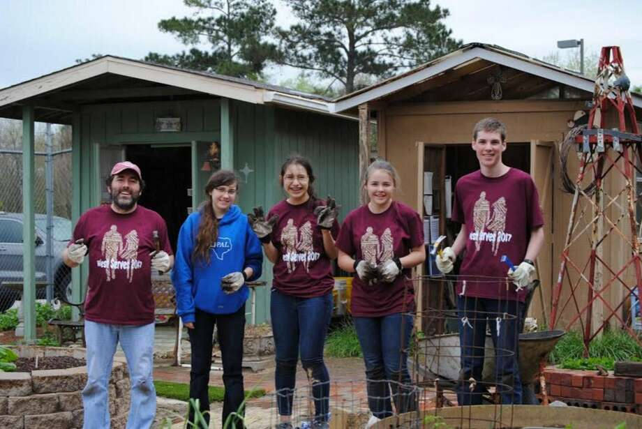The Magnolia West STEM team working at the community garden. Photo: DENISE MEYERS