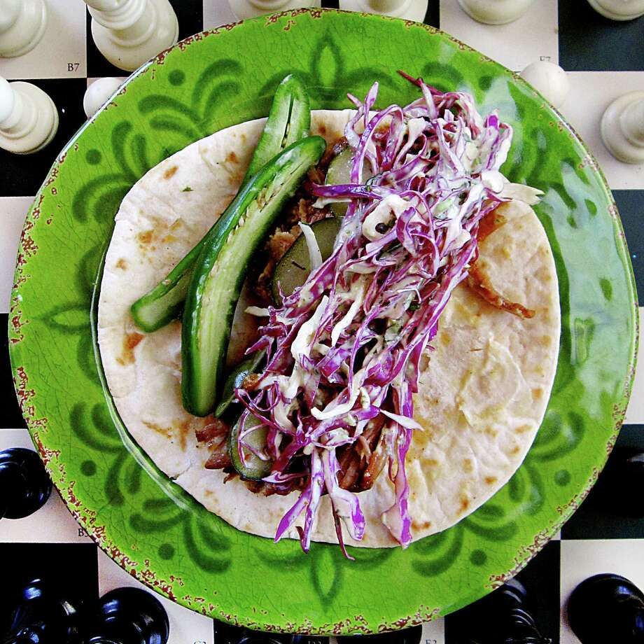 Week 11 Taco of the Week: El Purple Rain taco with barbecue pork, slaw and serranos at Sabinas Coffee House. Photo: Mike Sutter /San Antonio Express-News