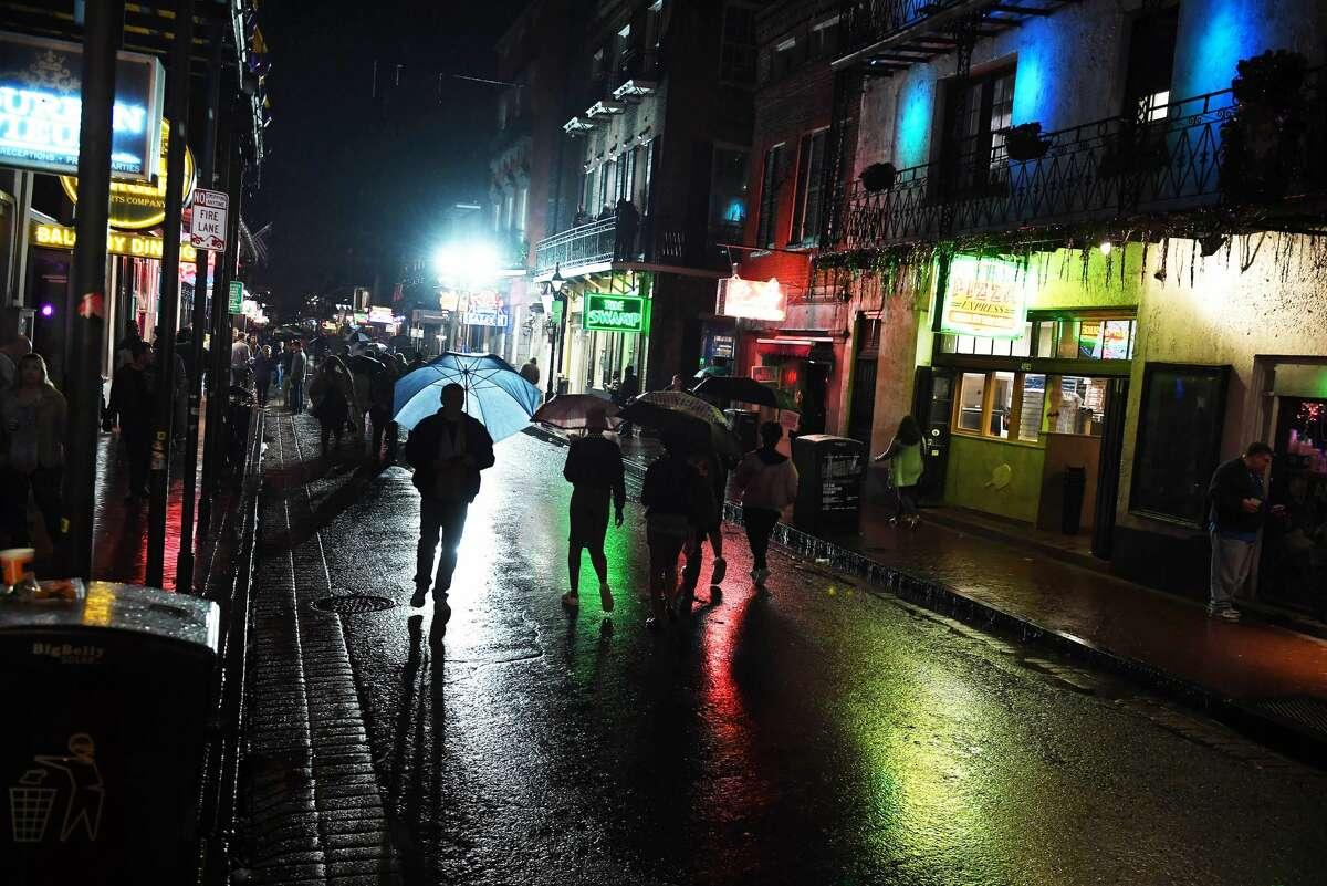 Colored lights gleam on the pavement on Bourbon Street in the French Quarter during a rain soaked evening on Friday February 17, 2017 in New Orleans. Click through to check out scenes from this year's Mardi Gras...