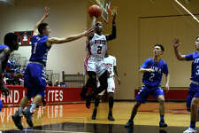 Kountze's TJ Stanford shoots against Buna during a 23-3A boys' basketball game in Kountze on Friday night.  Photo taken Friday 1/20/17 Ryan Pelham/The Enterprise