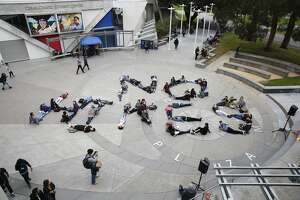 Students spell out No Hikes during an anti tuition increase demonstration at San Francisco State University on Wednesday, March 15, 2017 in San Francisco, Calif.