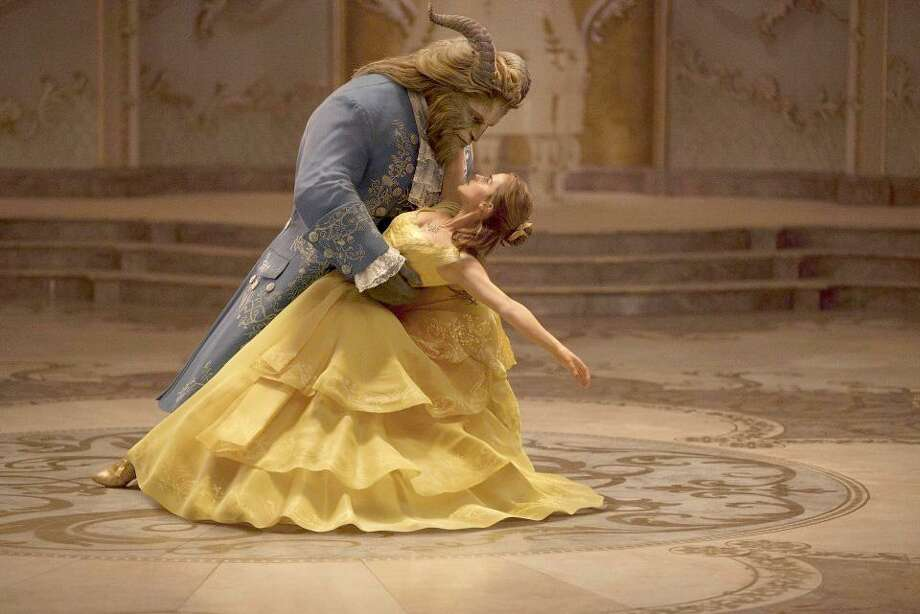 "Emma Watson stars as Belle and Dan Stevens as the Beast in Disney's ""Beauty and the Beast,"" a live-action adaptation of the studio's animated classic. Disney's latest re-imagining marks a big test of the company's strategy of using live actors to make beloved animated tales more relevant to new generations. Photo: Walt Disney Studios /Walt Disney Studios / Walt Disney Studios"