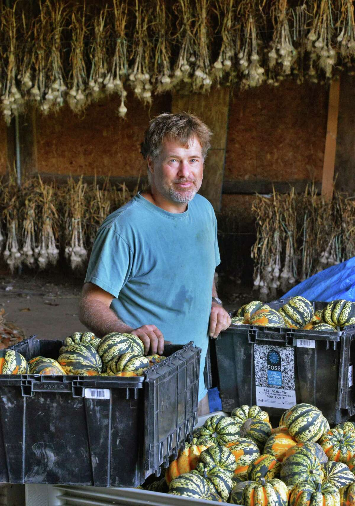 Farmer Thomas Christenfeld with harvested vegetables in a barn at his The Alleged Farm Tuesday Sept. 9, 2014, in Easton, NY. (John Carl D'Annibale / Times Union)