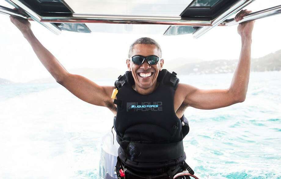 Enjoying his post-White House life, former President Barack Obama kitesurfs off the coast of Moskito Island in the British Virgin Islands in the Caribbean. A reader says he is hearing and reading more about Obama than when he was in office, and he is tired of it. Photo: JACK BROCKWAY /AFP /Getty Images / Virgin Virgin