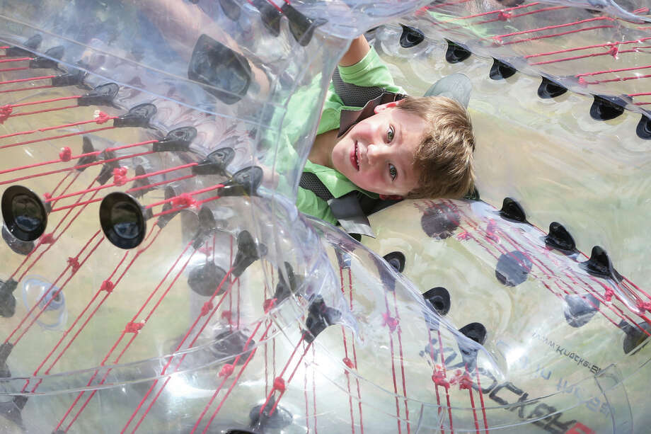 Corbin Roberts, of Spring, plays in an inflatable tumbler during the Woodlands Family Fun Fest on Saturday, July 18, 2015, at Town Green Park. Photo: Michael Minasi, Staff / © 2017 Houston Chronicle