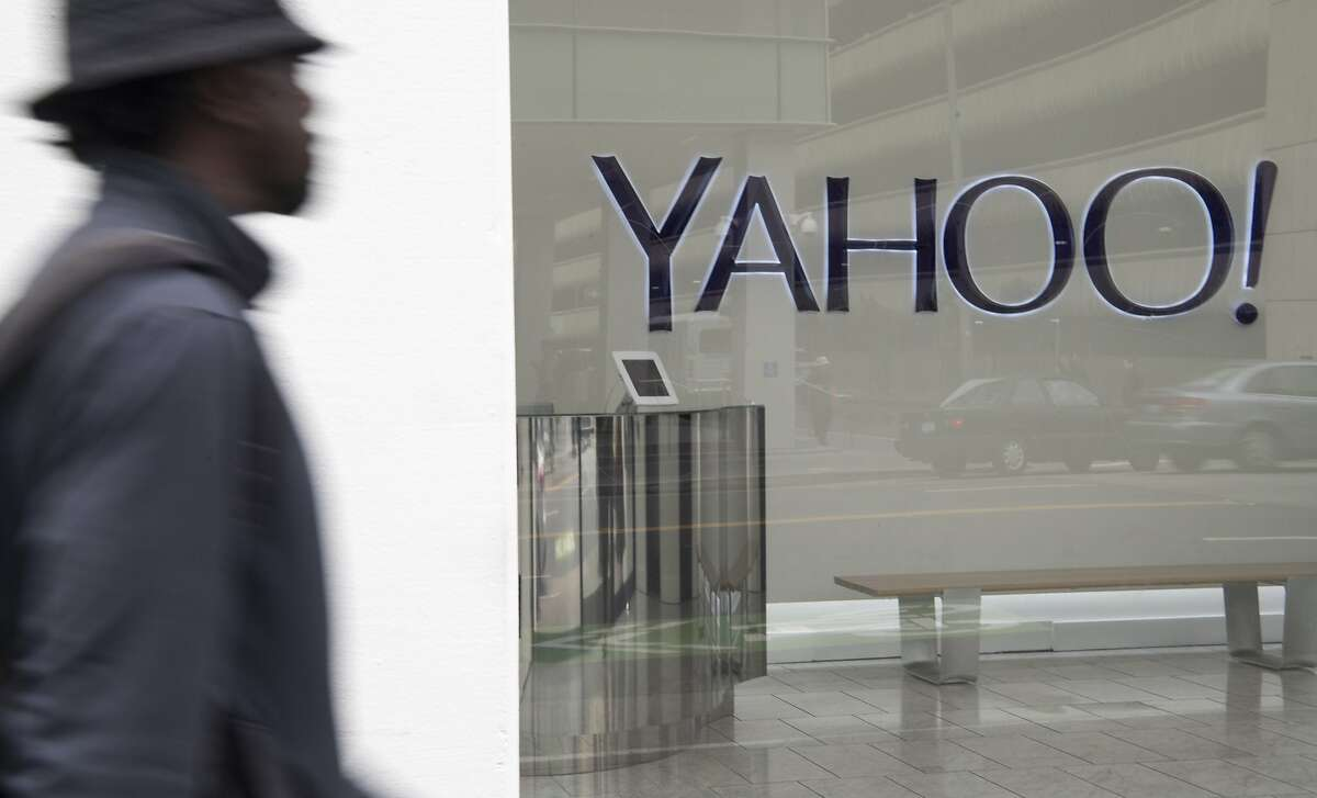 A man walks by the entrance of Yahoo! In San Francisco on March 15, 2017. Today, the FBI announced that Russian intelligence agents were responsible for a U.S. cyber attack on Yahoo! and are being pursued.