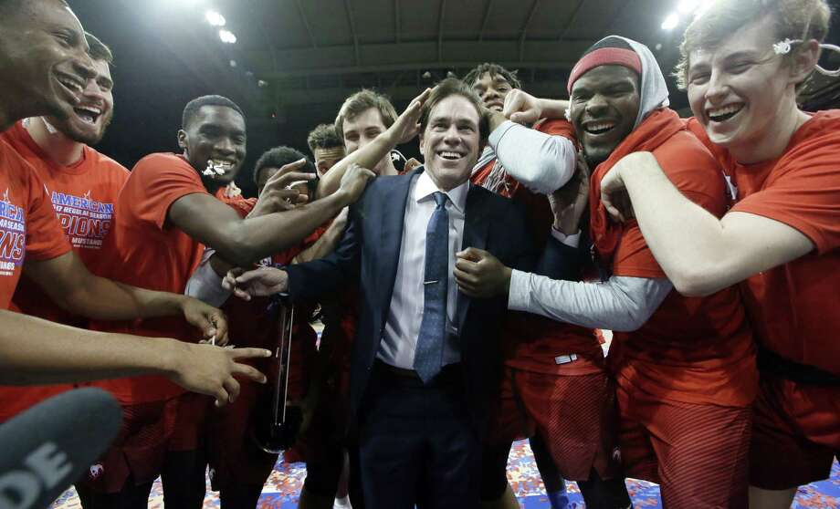 SMU coach Tim Jankovich celebrates with his players after defeating Memphis 103-62 in the American Athletic conference final in Dallas on March 4, 2017. Jankovich isn't going to complain about a No. 6 seed for the AAC champion with a 16-game winning streak. After being banned from last year's NCAA college basketball tournament despite 25 wins, the Mustangs are happy to be back in the 68-team NCAA field Photo: LM Otero /Associated Press / Copyright 2017 The Associated Press. All rights reserved.