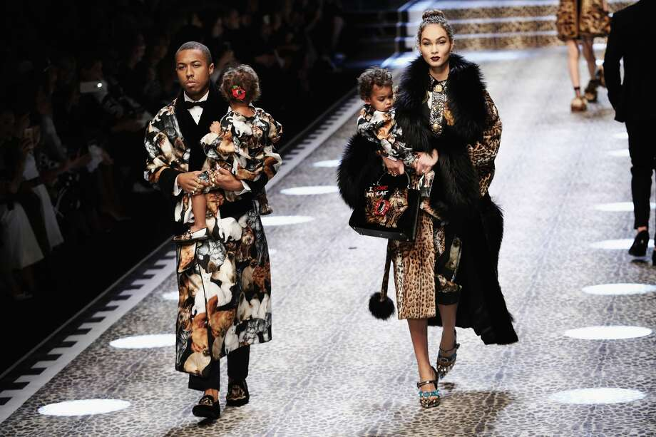 Amanda and Jason Harvey with their children Noah and Rose walk the runway at the Dolce & Gabbana show during Milan Fashion Week Fall/Winter 2017/18 on February 26, 2017 in Milan, Italy. Photo: Vittorio Zunino Celotto/Getty Images
