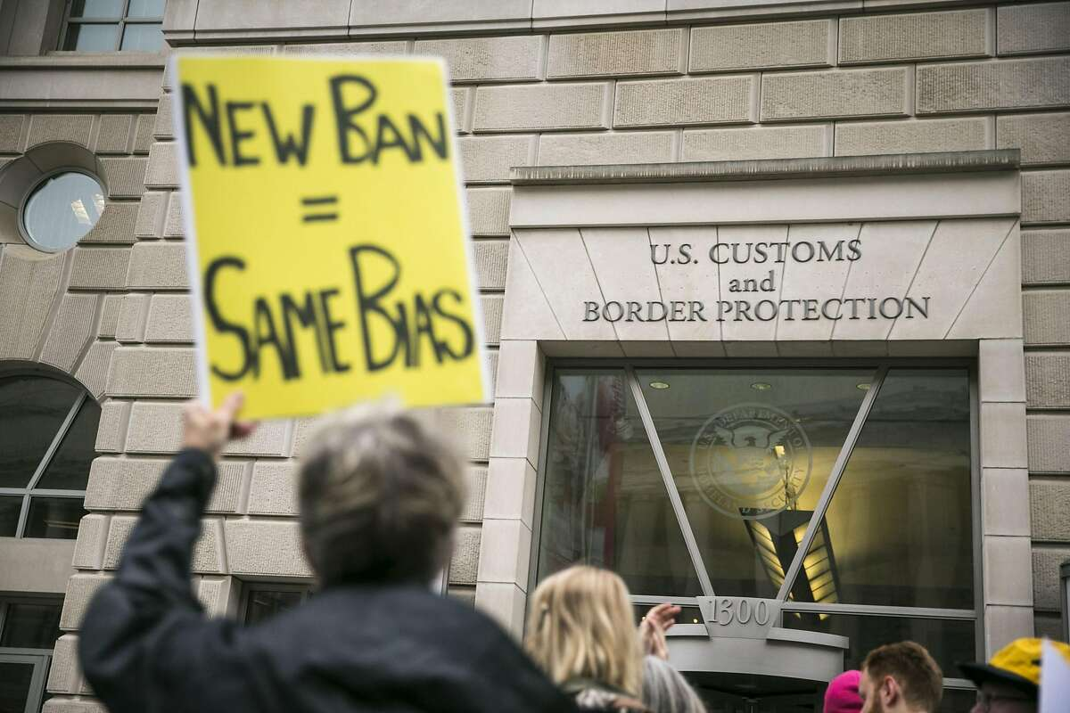 FILE -- Protesters demonstrate against President Donald Trump�s revised travel ban, outside the U.S. Customs and Border Protection headquarters in Washington, March 7, 2017. Trump�s new executive order sharply restricting travel from the Middle East is set to go into effect just after midnight Thursday, even as the measure faces an array of legal challenges from nonprofit groups and Democratic state attorneys general.(Al Drago/The New York Times)