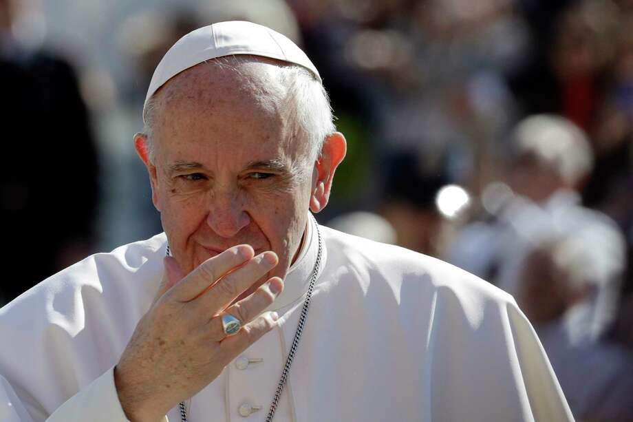 Pope Francis gestures as he arrives for his weekly general audience in St. Peter square at the Vatican, Wednesday, March 15, 2017. (AP Photo/Andrew Medichini) Photo: Andrew Medichini, STF / Copyright 2017 The Associated Press. All rights reserved.