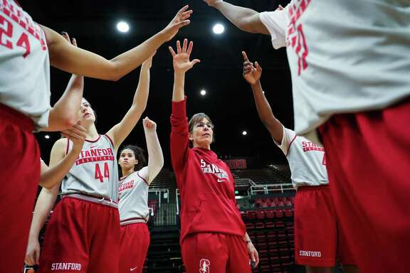 Stanford women's basketball team head coach Tara VanDerveer (center) does a cheer with her players during practice at Maples Pavillion in Palo Alto, California, on Wednesday, Feb. 1, 2017.