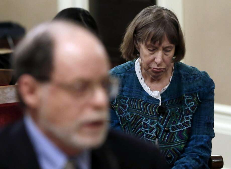 Diane Bernbaum lowers her head as her husband, Edwin Bernbaum (left) speaks to a state Senate committee. Photo: Rich Pedroncelli, Associated Press