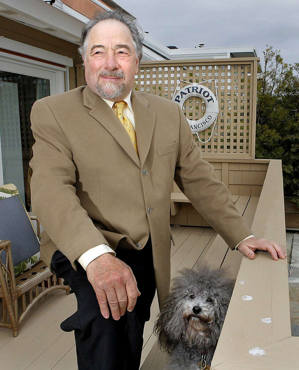 """** FILE ** In this Monday, Dec. 3, 2007 file photo, radio talk show host Michael Savage poses with his dog Teddy in Tiburon, Calif. Radio talk show host Michael Savage, who described 99 percent of children with autism as brats, said Monday July 21, 2008 he was trying to """"boldly awaken"""" parents to his view that many people are being wrongly diagnosed. (AP Photo/John Storey)"""