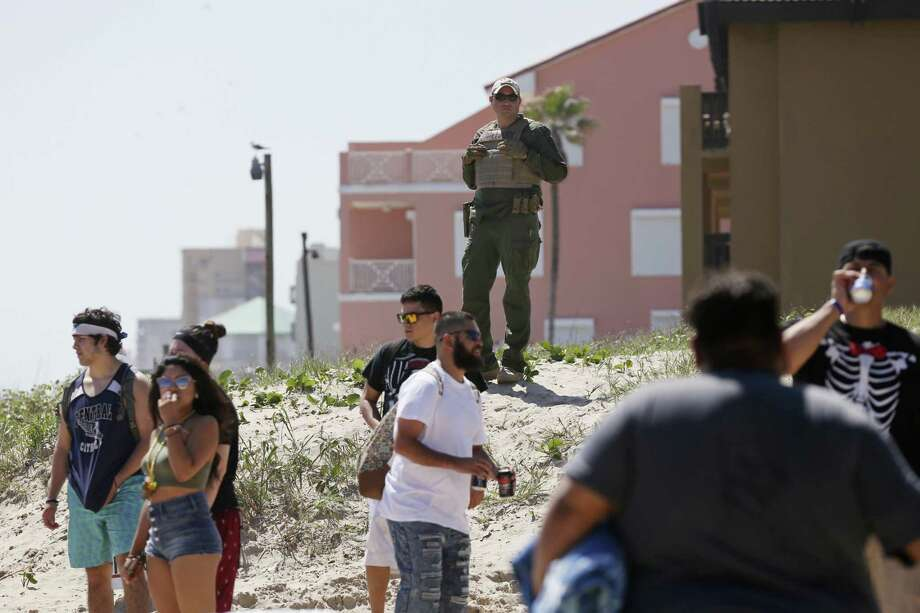 Law enforcement agents from federal to local levels keep an eye on the crowd at Clayton's Beach Bar and Grill in South Padre Island, Tuesday, March 14, 2017. Spring Break brings thousands of visitors to the island and last year, sales revenues grossed $30.5 million. Photo: Photos By Jerry Lara / San Antonio Express-News / © 2017 San Antonio Express-News