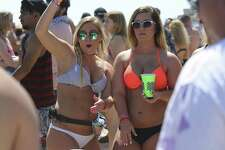 Amber Braun, 22, left, and Payton Holtmeyer, 21, students at Lincoln University of Missouri, play beer pong at Clayton's Beach Bar and Grill in South Padre Island, Tuesday, March 14, 2017. Spring Break brings thousands of visitors to the island and last year, sales revenues grossed $30.5 million.