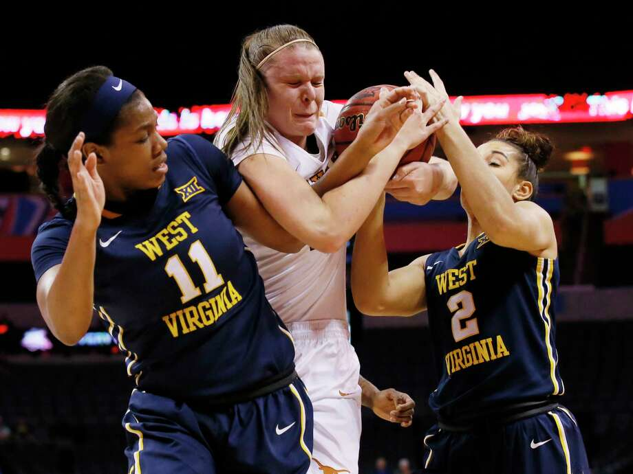 West Virginia forward Teana Muldrow (11), Texas center Kelsey Lang, center, and West Virginia guard Alexis Brewer (2) fight for the ball in first half of an NCAA college basketball game at the Big 12 Conference tournament in Oklahoma City, Sunday, March 5, 2017. (AP Photo/Sue Ogrocki) Photo: Sue Ogrocki, STF / AP2017