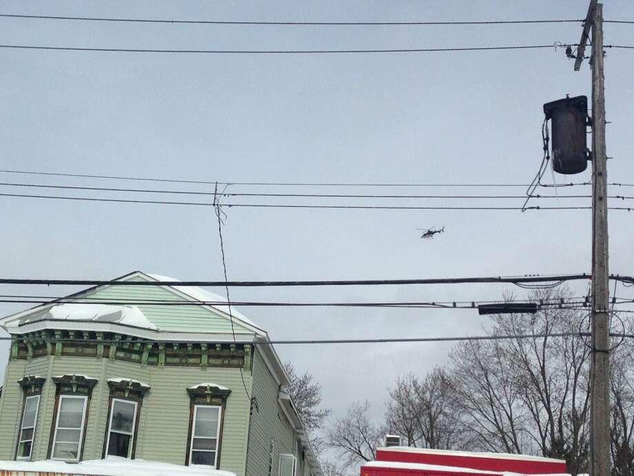 A State Police helicopter was in the air as Schenectady police conducted a ground search after a man was shot near 787 State St. in Schenectady on Wednesday, March 15, 2017. (Paul Nelson/Times Union)