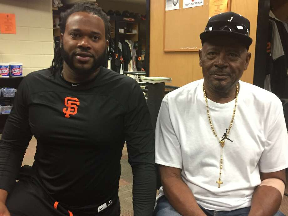 Giants pitcher Johnny Cueto, left, with his father, Domingo, last spring training. Cueto brought his dad to Arizona to continue caring for him after tending to him in the Dominican Republic. Photo: John Shea