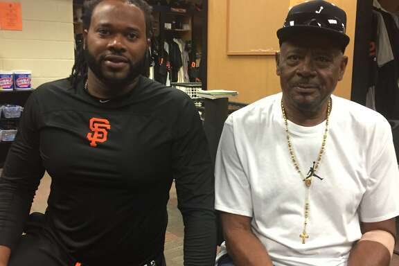San Francisco Giants pitcher Johnny Cueto, left, with his 71-year-old father, Domingo, in Scottsdale, Ariz., for spring training.