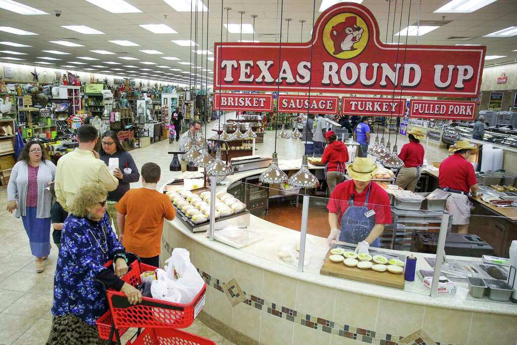 Shoppers look at the barbecue station at the Buc ee s in Baytown Thursday   March. Buc ee s sues Bucky s for trying to expand into Texas   Houston