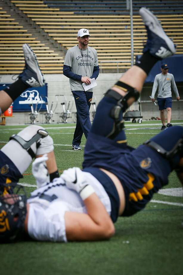 Players run drills as head coach Justin Wilcox watches at Cal football's first spring practice on Wednesday, March 14, 2017 in Berkeley, Calif. Photo: Amy Osborne, Special To The Chronicle