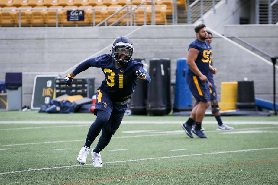 Inside line backer Raymond Davison runs drills at Cal football's first spring practice on Wednesday, March 14, 2017 in Berkeley, Calif. Photo: Amy Osborne, Special To The Chronicle