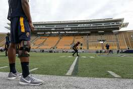 Players run drills at Cal football's first spring practice on Wednesday, March 14, 2017 in Berkeley, Calif.
