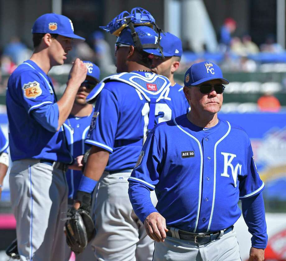 Kansas City Royals manager Ned Yost walks away from the mound after relieving Jake Junis during a spring training game against the Texas Rangers in Surprise, Ariz., on Saturday, Feb. 25, 2017. The Royals won, 7-5. (John Sleezer/Kansas City Star/TNS) Photo: John Sleezer, MBR / Kansas City Star