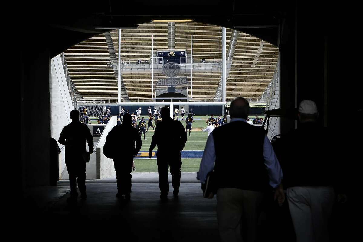 People enter the stadium at the first day of Cal football's spring practice on Wednesday, March 14, 2017 in Berkeley, Calif.