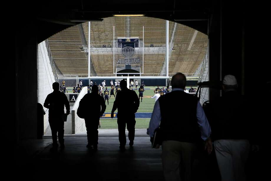 People enter the stadium at the first day of Cal football's spring practice on Wednesday, March 14, 2017 in Berkeley, Calif. Photo: Amy Osborne, Special To The Chronicle