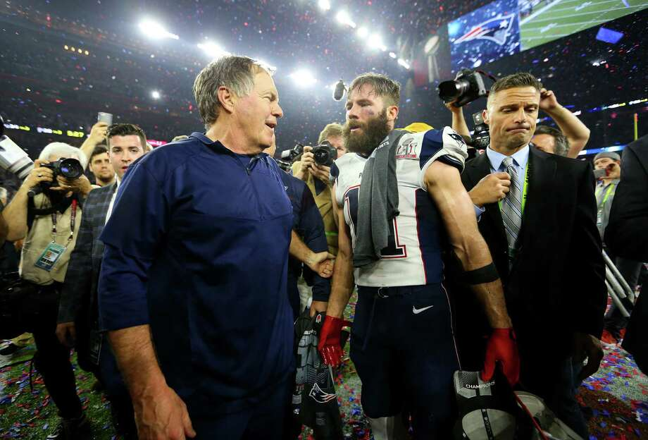 New England Patriots head coach Bill Belichick left, and New England Patriots wide receiver Julian Edelman celebrate after the Patriots defeated the Atlanta Falcons in Super Bowl LI at NRG Stadium on Sunday, February 5, 2017. ( Karen Warren / Houston Chronicle ) Photo: Karen Warren, Staff Photographer / 2017 Houston Chronicle