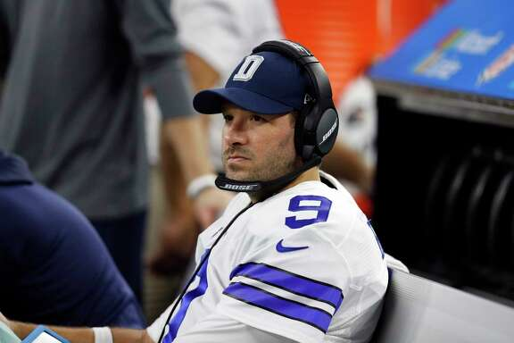 Dallas Cowboys' Tony Romo sits on the bench in the first half of an NFL football game against the Detroit Lions on Monday, Dec. 26, 2016, in Arlington, Texas. (AP Photo/Brandon Wade)