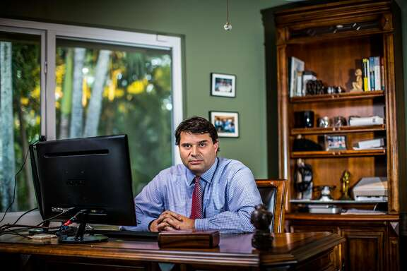 Dr. Thomas Albini at his home in Coral Gables, Florida. Albini co-authored a paper published Wednesday in the New England Journal of Medicine which describes three cases of elderly women who were treated with experimental stem cell therapies and ended up blind.