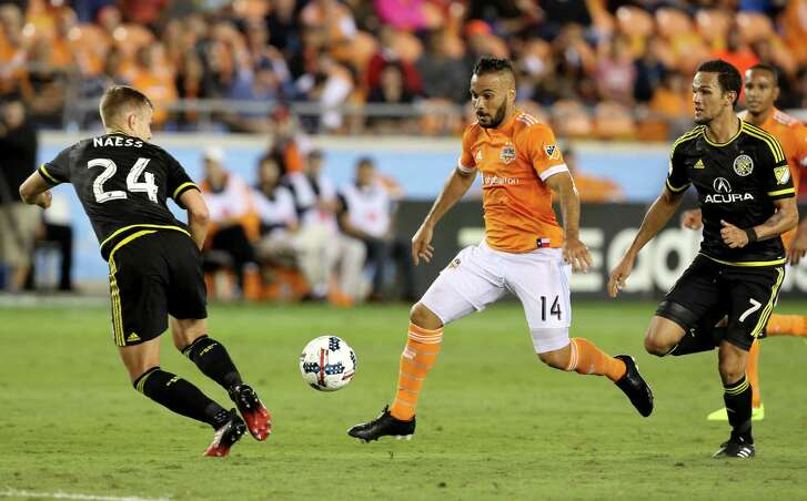 Columbus Crew players Nicolai Naess (24) and  midfielder Artur (7) attempts to stop Houston Dynamo midfielder Alex (14) from moving down the field during the first half of the MLS soccer game at BBVA Compass Stadium Saturday, March 11, 2017, in Houston. The Dynamos defeated the Crew 3-1. ( Yi-Chin Lee / Houston Chronicle )