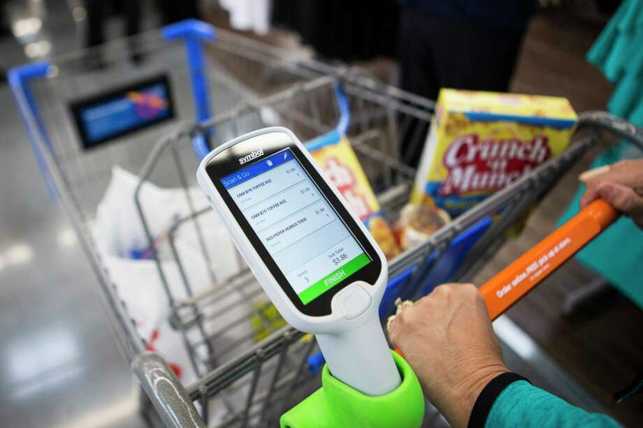 Wal-Mart's new Scan & Go technology allows customers to skip checkout lines by scanning items and paying with mobile phones or store-provided devices. Photo: Brett Coomer, Staff / © 2017 Houston Chronicle