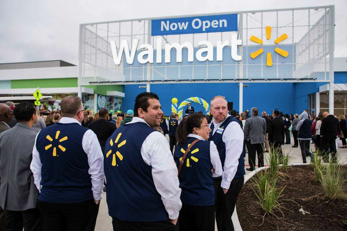 Wal-Mart associates stand outside the store for the grand opening ceremony of the new Wal-Mart on Wednesday, Feb. 15, 2017, in Tomball. ( Brett Coomer / Houston Chronicle )