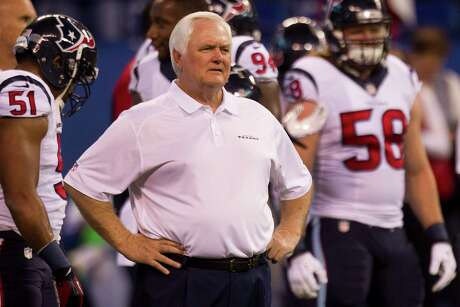 Houston Texans interim head coach Wade Phillips watches the Texans warm up before their game against the Indianapolis Colts at Lucas Oil Stadium Sunday, Dec. 15, 2013, in Indianapolis. ( Brett Coomer / Houston Chronicle )