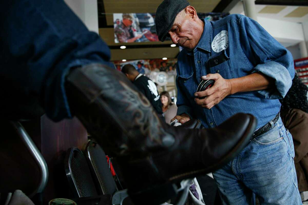 Shoeshiner John Lopez works his magic on a pair of boots at the Houston Livestock Show and Rodeo Wednesday, March 15, 2017 in Houston.