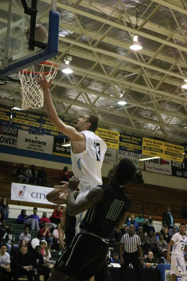 Konstantin Kulikov drops in two of his 15 points during last Saturday night's Region 14 championship game against Panola. He and the rest of the Ravens have been seeded first for next week's national championship tournament. Photo: Robert Avery