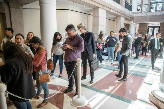 """A large group of people wait in line to attend the """"sanctuary cities"""" meeting at the Texas State Capitol in Austin on Wednesday. Action on the bill is likely to take awhile."""