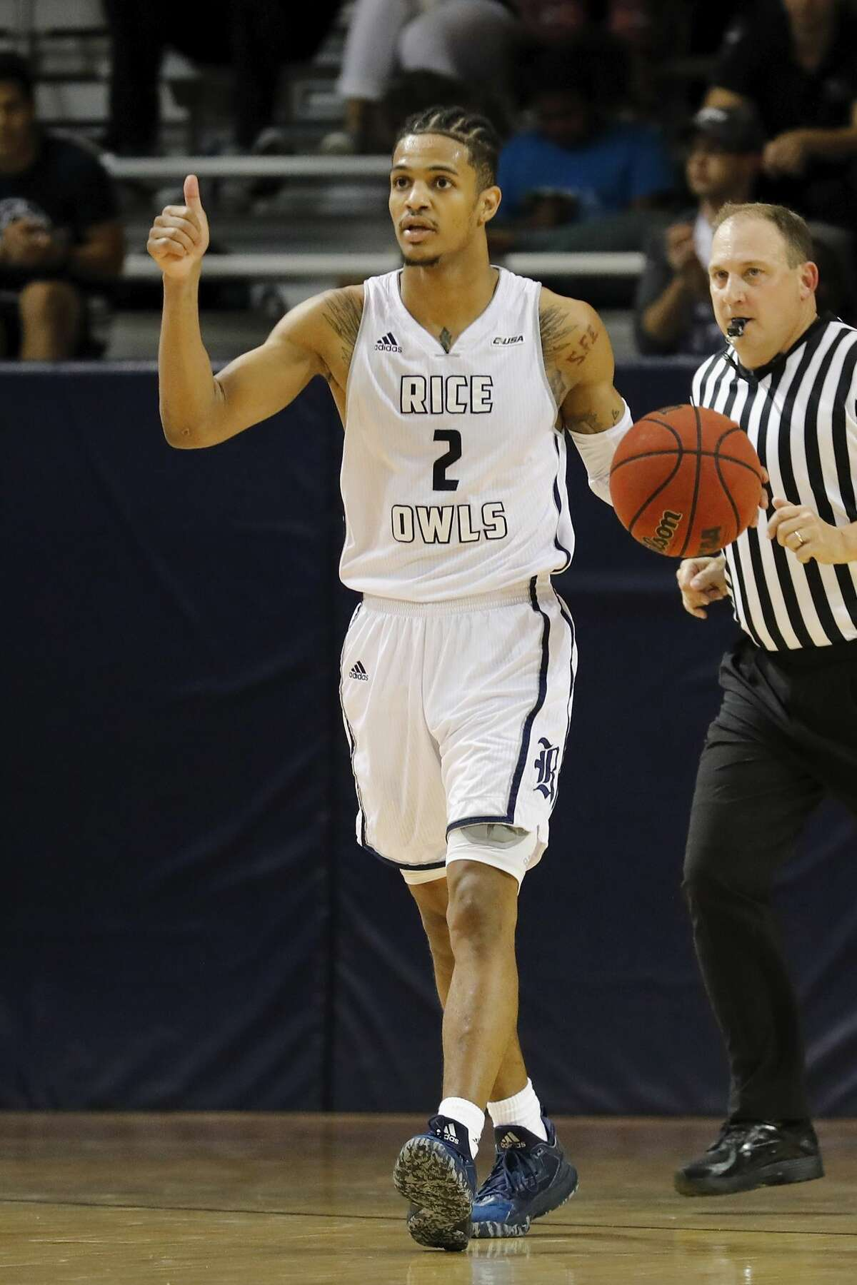 Rice Owls guard Marcus Evans #2 brings the ball up the court during the second half of the College Basketball Invitational first round game between the San Francisco Dons and the Rice Owls at Tudor Field House in Houston, TX on Wednesday, March 15, 2017. The Owls defeated the Dons 85-76.