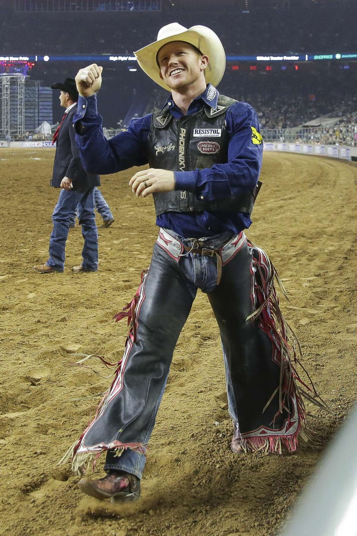 Saddle bronc rider Jacobs Crawley celebrates after he scored 91 points for a first place ride during round three of Super Series III at the Houston Livestock Show and Rodeo Wednesday, March 15, 2017 in Houston. ( Michael Ciaglo / Houston Chronicle )