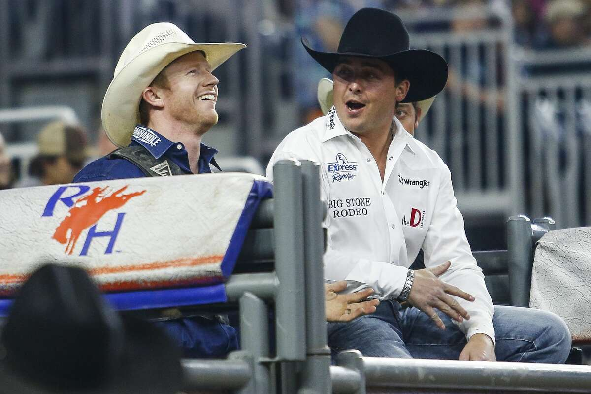 Saddle bronc rider Jacobs Crawley, left, celebrates behind the chutes after he scored 91 points for a first place ride during round three of Super Series III at the Houston Livestock Show and Rodeo Wednesday, March 15, 2017 in Houston. ( Michael Ciaglo / Houston Chronicle )