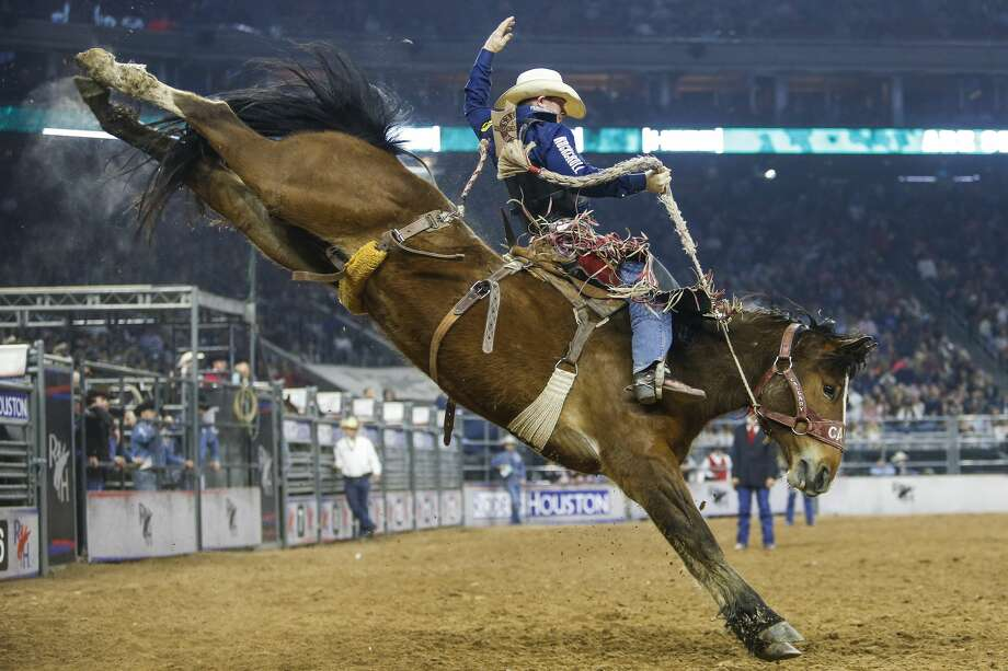 Saddle bronc rider Jacobs Crawley rides Xena Warrior during round three of Super Series III at the Houston Livestock Show and Rodeo Wednesday, March 15, 2017 in Houston. Crawley placed first with a score of 91.( Michael Ciaglo / Houston Chronicle ) Photo: Michael Ciaglo/Houston Chronicle