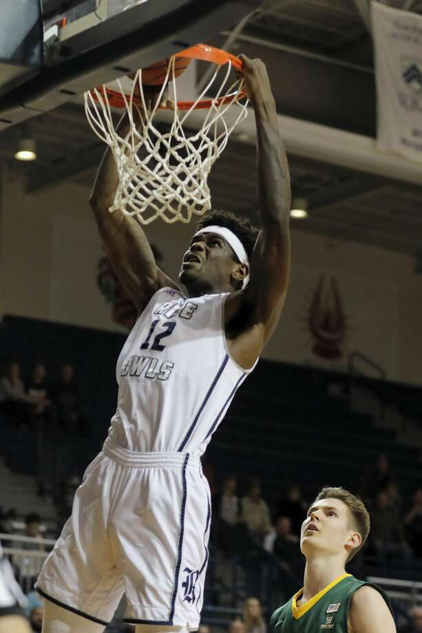 Rice Owls forward Marquez Letcher-Ellis #12 dunks the ball during the first half of the College Basketball Invitational first round game between the San Francisco Dons and the Rice Owls at Tudor Field House in Houston, TX on Wednesday, March 15, 2017.  The Owls defeated the Dons 85-76. Photo: Tim Warner/For The Chronicle