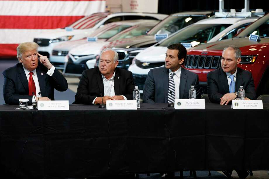 President Donald Trump speaks during a roundtable at the American Center of Mobility, Wednesday, March 15, 2017, in Ypsilanti Township, Mich. From left are, Trump, UAW president Dennis Williams, Ford CEO Mark Fields, and EPA administrator Scott Pruitt. (AP Photo/Evan Vucci) Photo: Evan Vucci, STF / Copyright 2017 The Associated Press. All rights reserved.