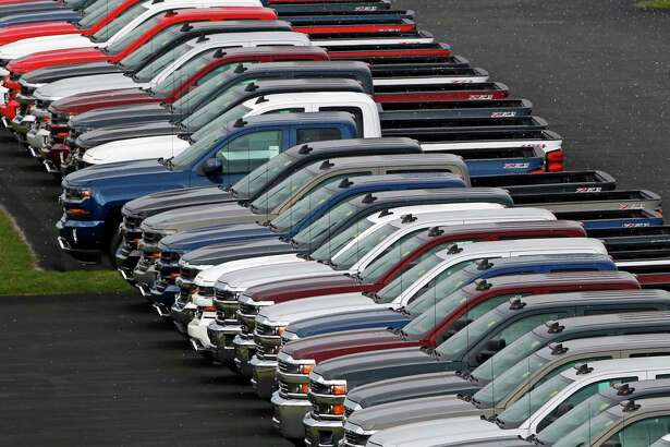 In this Thursday, Feb. 2, 2017, photo, Chevrolet pickup trucks appear on display at a dealership in Delmont, Pa. On Wednesday, March 15, 2017, the Commerce Department reports on business stockpiles in January. (AP Photo/Gene J. Puskar)