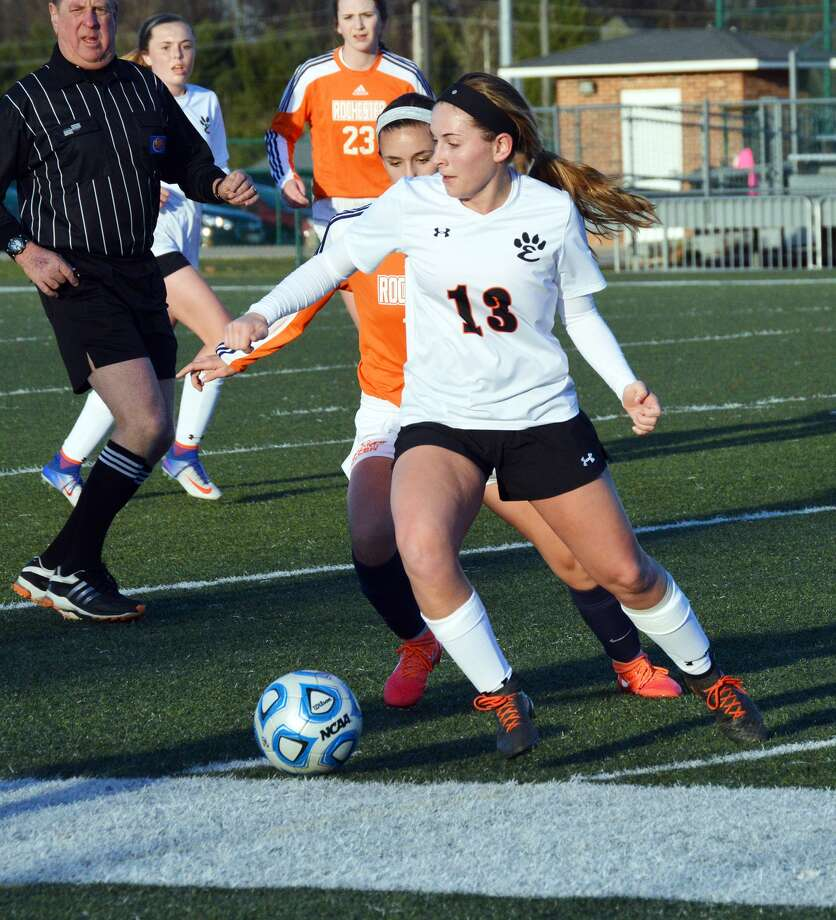 Edwardsville senior midfielder Ashlin West, front, shields the ball away from a Rochester player during first-half action at the District 7 Sports Complex.