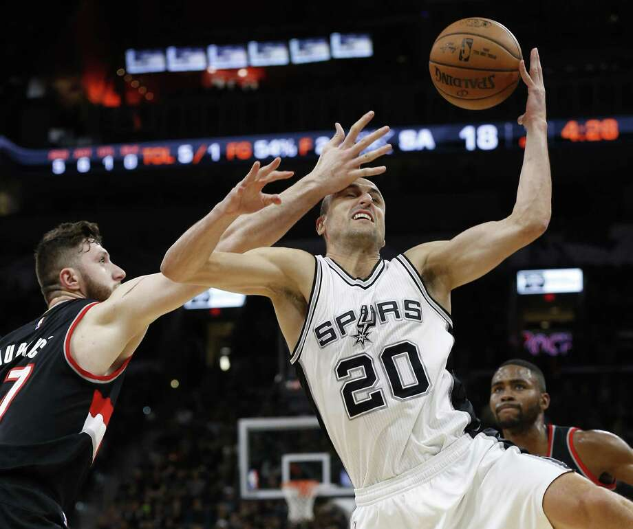 Spurs' Manu Ginobili steals the ball from Portland's Jusuf Nurkic (left) at the AT&T Center on March 15, 2017. Photo: Kin Man Hui /San Antonio Express-News / ©2017 San Antonio Express-News